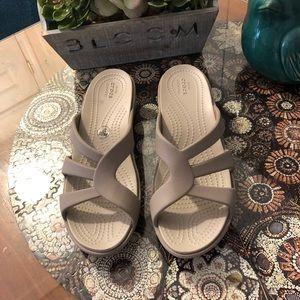 Crocs sandals never worn; Size 8